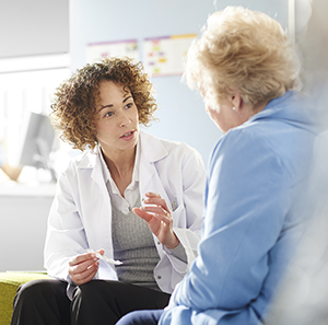 Image of Caregiver Educating Patient
