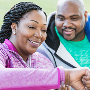 Couple looking at fitness tracker